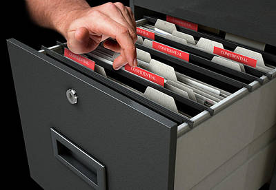 Hand Looking Though Filing Cabinet Drawer Poster