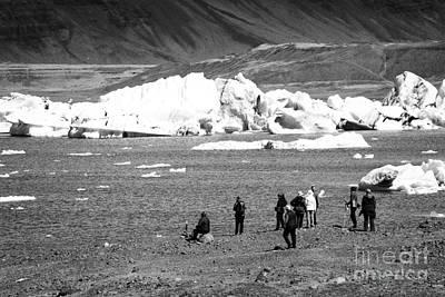middle aged tourists walking group at Jokulsarlon glacial lagoon Iceland Poster by Joe Fox