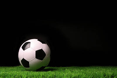Soccer Ball On Grass Against Black Poster