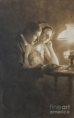 Vintage Loving Couple Reading With Oil Lamp Poster