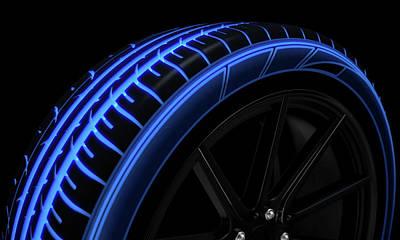 Tire Luminous Tread And Dark Background Poster