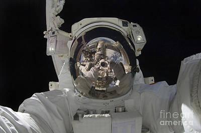 Astronaut Uses A Digital Still Camera Poster by Stocktrek Images