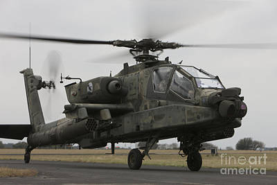 Ah-64 Apache Helicopter On The Runway Poster by Terry Moore