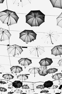 Umbrellas Poster by Tom Gowanlock