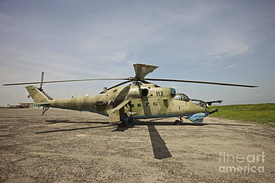 An Mi-35 Attack Helicopter At Kunduz Poster by Terry Moore
