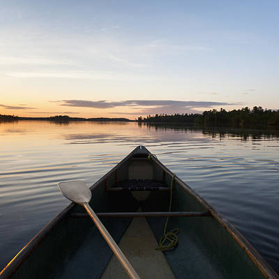 A Boat And Paddle On A Tranquil Lake Poster by Keith Levit