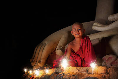 A Boy In Buddhism Set Fire With Candle In Bagan Poster