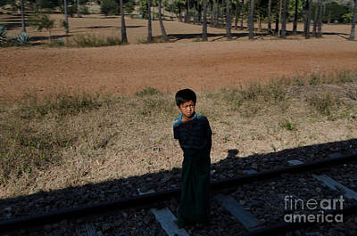 A Boy In Burma Looks Towards A Train From The Shadows Poster