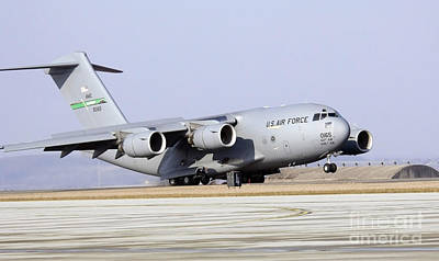 A C-17 Globemaster IIi Lands Poster by Stocktrek Images