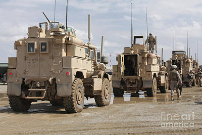 A Convoy Of Mrap Vehicles Near Camp Poster by Stocktrek Images