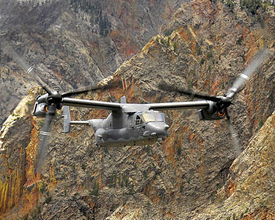 A Cv-22 Osprey Flies Over The Canyons Poster by Stocktrek Images