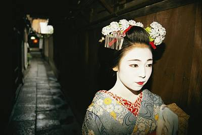A Geisha In Traditional Costume Walks Poster