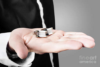 A Male Model Showcasing Cuff Links In His Hand Poster