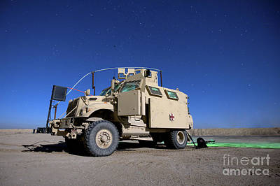 A Maxxpro Mrap Vehicle Under A Starry Poster
