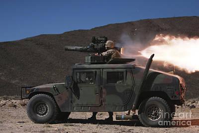 A Missileman Firing A Bgm-71 Tow Poster by Stocktrek Images