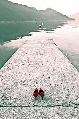 A Pair Of Red Women's Shoes Lying On A Walkway That Leads Into A Poster by Joana Kruse