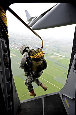 A Paratrooper Executes An Airborne Jump Poster by Stocktrek Images
