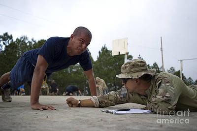 A Tigres Commando Conducts Push-ups Poster