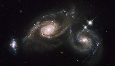 A Triplet Of Galaxies Known As Arp 274 Poster