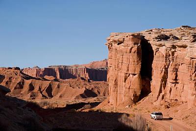 A Truck Drives Through The Desert Poster