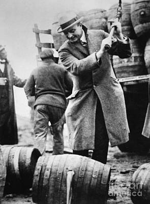 A Us Federal Agent Broaching A Beer Barrel From An Illegal Cargo During The American Prohibition Era Poster by American School