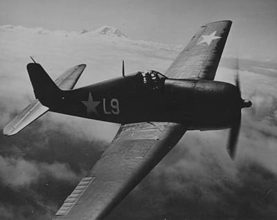 A Us Navy Hellcat Fighter Aircraft In Flight Poster