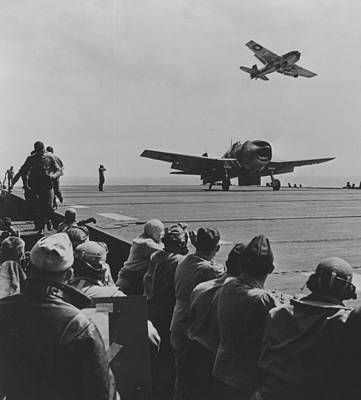 A Us Navy Hellcat Fighter Aircraft Landing On The Deck Of A Carrier Poster
