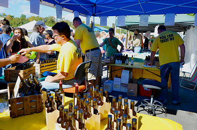 A Vendor At The Garlic Fest Offers Garlic Vinegar And Olive Oil For Sale Poster by Lanjee Chee