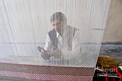 A Weaver Weaves A Carpet. Poster