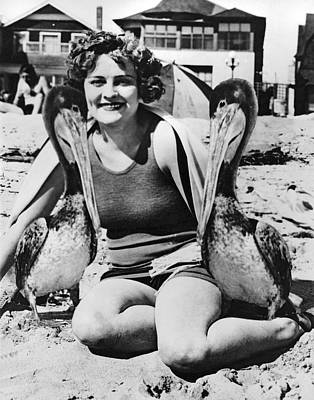 A Woman And Her Pet Pelicans Poster by Underwood Archives