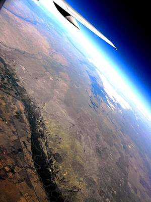 Above The Earth Poster by Elizabeth Hoskinson