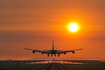Aeroplane Landing At Sunset Poster by David Nunuk
