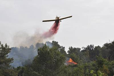Aircraft Drops Fire Retardant Poster by Photostock-israel