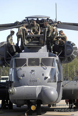 Airmen Conduct Training On The Mh-53 Poster by Stocktrek Images