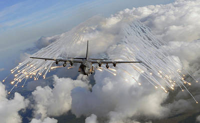 An Ac-130u Gunship Jettisons Flares Poster by Stocktrek Images