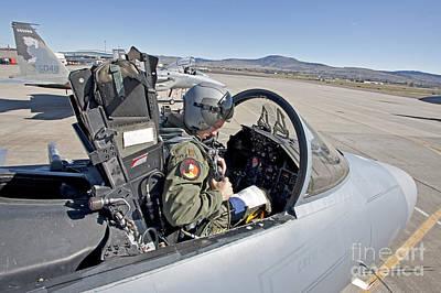 An F-15 Pilot Performs Preflight Checks Poster