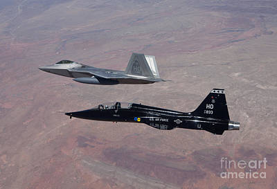 An F-22 Raptor And A T-38 Talon Fly Poster by HIGH-G Productions