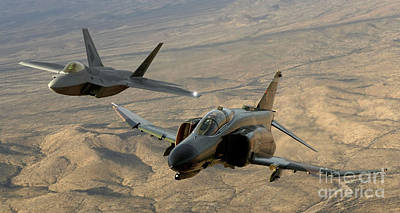 An F-4 Phantom And An F-22a Raptor Fly Poster