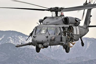 An Hh-60 Pave Hawk Helicopter In Flight Poster