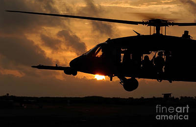 An Hh-60g Pave Hawk Helicopter Prepares Poster