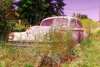 An Old Car Left In The Weeds Poster
