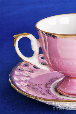 Antique Pink Cup And Saucer On Blue Textured Background Poster