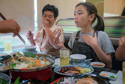 Asian Family Party With Shaby Sukiyaki Set Manu In Restaurant Poster