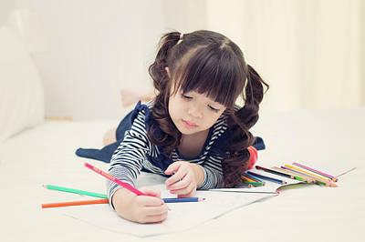 Asian Kid Drawing And Do Homework On The Bed  Poster