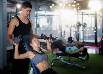 Asian Trainer And Lady Take Personal Training In Fitness Club Poster