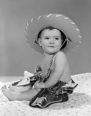 Baby In Cowboy Gear, 1960s Poster by H. Armstrong Roberts/ClassicStock