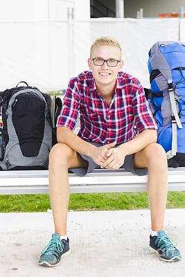 Backpacker Man Sitting At Bus Stop Poster