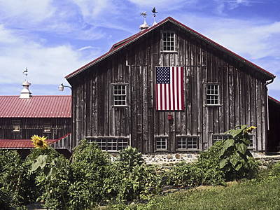 Barn And American Flag Poster by Sally Weigand