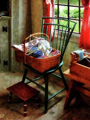 Basket Of Cloth And Yarn On Chair Poster