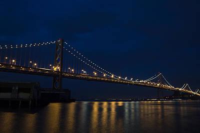 Bay Bridge At Night Poster by John Daly